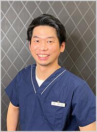 歯科医師 根本哲郎